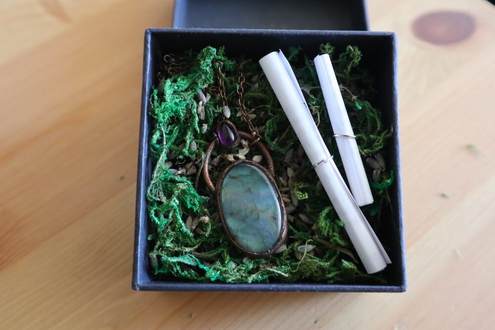 jewelry box with moss and notes